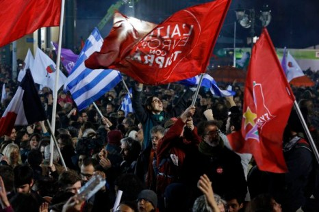 Supporters of radical leftist Syriza party chant slogans and wave Greek national and other flags after winning elections in Athens
